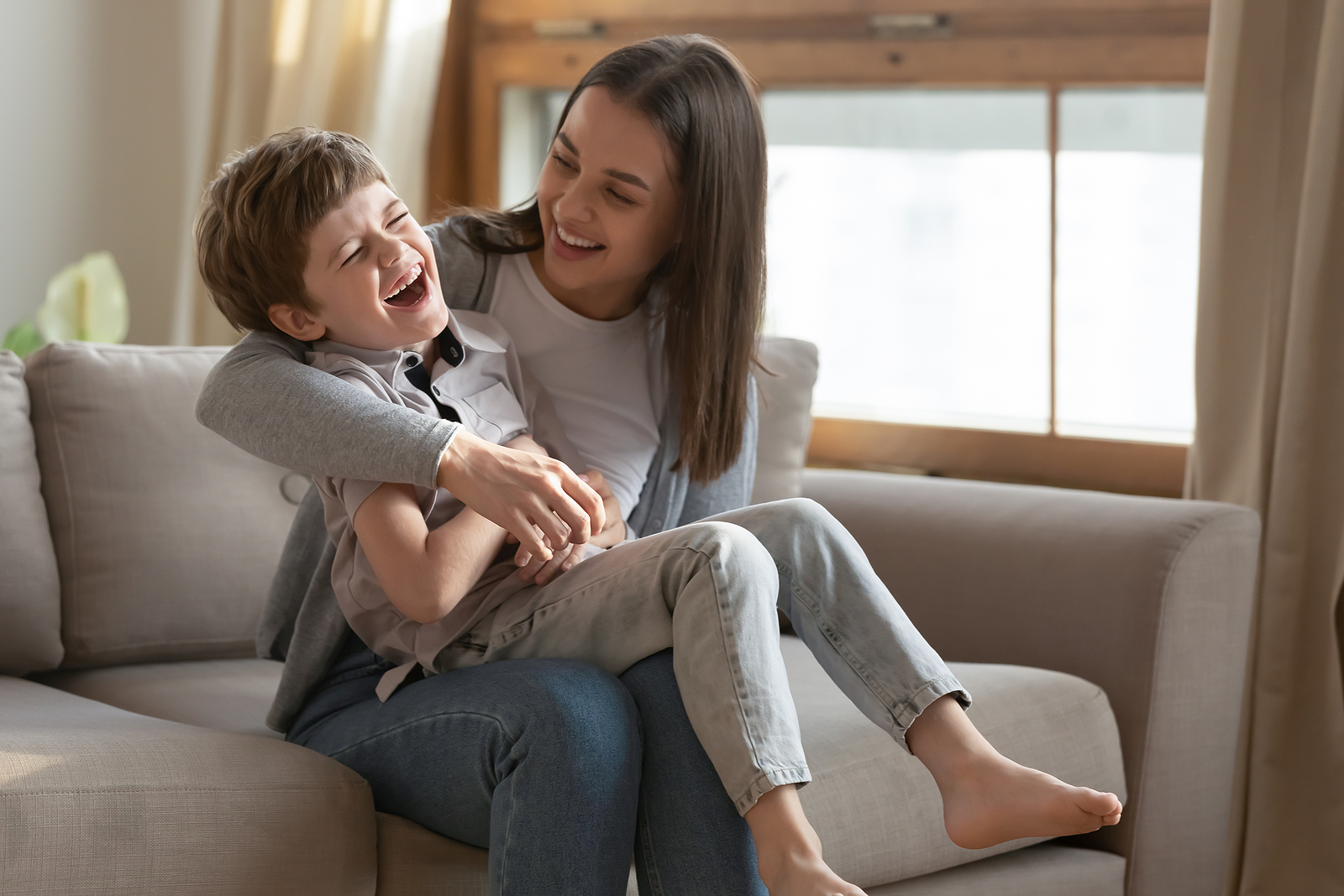 Child and Mom on couch needing hotel babysitting service